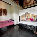 bed and sofa at villa rumah lotus