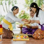 our guide will help you to make canang sari at villa cemadik by ubudvillasrental