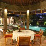 pool view at night with circle table villa griya atma