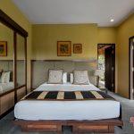king size bedroom at villa kelusa pondok surya