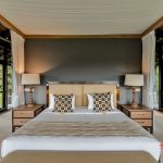 king size bedroom with forest view at villa kelusa pondok sapi