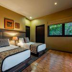 double bed at villa kelusa pondok surya