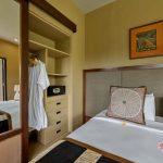 simple but comfortable bedroom at villa kelusa at pondok surya