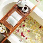 bathtub with teacup and book at villa kelusa pondok sapi2