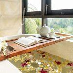 bathtub with teacup and book at villa kelusa pondok sapi