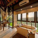 bathtub with valley view at villa kelusa pondok sapi
