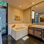 an elegant bathroom view with beautiful bathtub at villa kelusa pondok sapi2