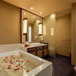 an elegant bathroom view with beautiful bathtub at villa kelusa pondok sapi