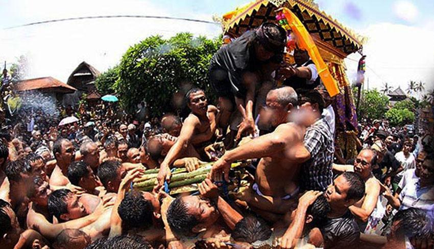 Balinese Tradition: Mesbes Bangke (Tearing the Corpse)